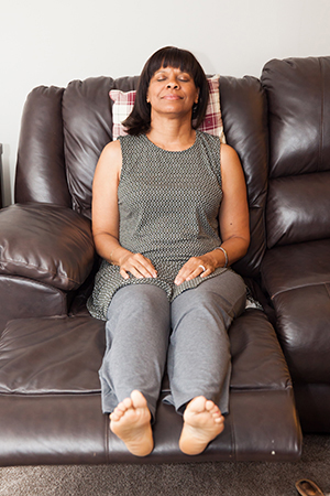 Woman relaxing in easy chair with eyes closed