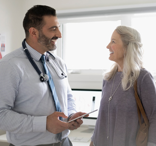 Doctor talking with woman in exam room