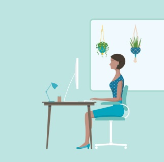 Woman sitting at a desk with good posture