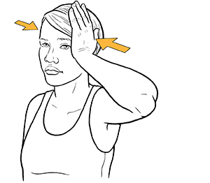 Woman holding hand to side of head doing neck isometric exercise.