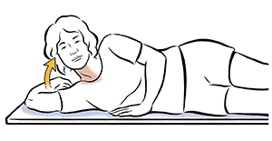 Woman lying on side doing head lift exercise.